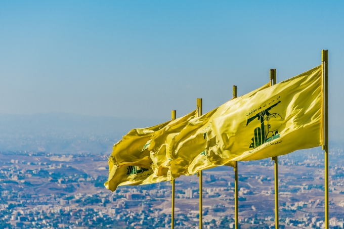 Hezbollah flags fly over southern Lebanese land