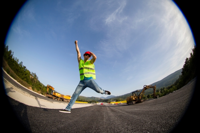 Construction worker smiling and jumping