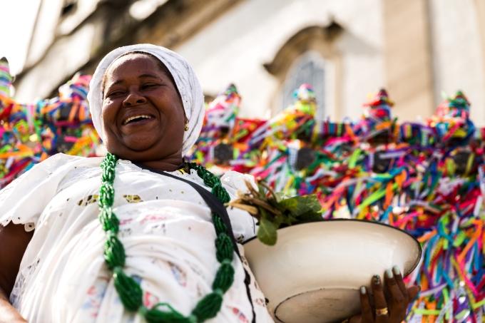 cultura bahia Candomble priestess wearing traditional clothes at Bonfim Church in Salvador, Bahia, Brazil