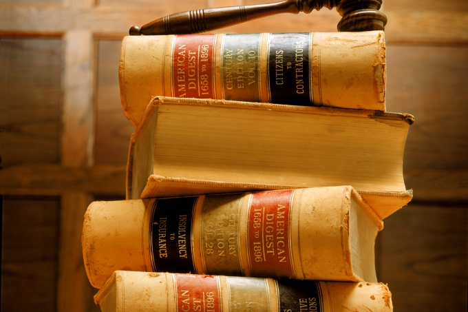 Stacked law books and gavel